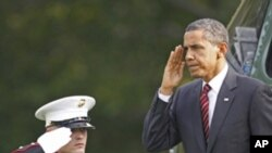 President Barack Obama returns a salute as he steps off the Marine One helicopter on the South Lawn at the White House in Washington, Monday, Oct. 10, 2011.