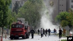 Security officers and firefighters work moments after an explosion outside the Police headquarters in Gaziantep, Turkey, May 1, 2016.