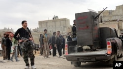 Members of the Free Syrian Army are seen deployed in al-Bayada, Homs, February 29, 2012.