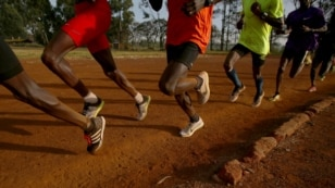 FILE - Athletes exercise in the early morning in the sports ground of the University of Eldoret in western Kenya, March 21, 2016.