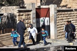 Schoolchildren evacuate a school after shelling by Syrian rebels on government-held western Aleppo, Syria, in this handout picture provided by SANA on Nov. 20, 2016.