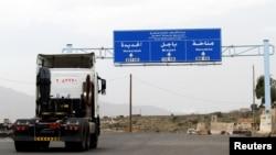 A truck drives on the main road linking Hodeidah with Sanaa, Yemen, Sept.13, 2018.