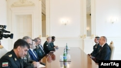 Azərbaycan prezidenti İlham Əliyev İran İslam Respublikasının Sərhəd Qoşunlarının komandanı Qasım Rzayinın başçılıq etdiyi nümayəndə heyətini qəbul edib, 11 dekabr, 2018.