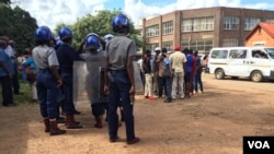 Riot police ready to pounce at a street march organized by members of the National Electoral Reform Agenda (NERA), protesting against the Zimbabwe Electoral Commission's failure to conduct a transparent voter registration exercise.