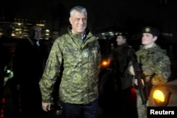 FILE - Kosovo's President Hashim Thaci walks past soldiers of Kosovo Security Force during the army formation ceremony in Pristina, Kosovo, Dec. 14, 2018.