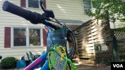 A bike awaits a 17-year-old refugee at the Ralbovsky home in Greenbelt, Maryland. The couple plan to take their foster son to the nearby farmers' market and summer music festivals if the U.S State Department approves his travel to the U.S. (A. Arabasadi/V