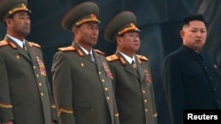 North Korean leader Kim Jong-un (R) stands with military officers in Pyongyang April 13, 2012.