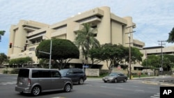 FILE - The federal building housing U.S. District Court in Honolulu, March 7, 2014. U.S. District Judge Derrick Watson halted President Donald Trump's revised travel ban this month, hours before it was due to take effect.