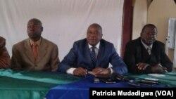 Chris Mutsvangwa (center)