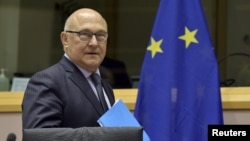 French Minister of Finance Michel Sapin arrives at the committee on economic and monetary affairs in Brussels, Belgium, May 7, 2015.