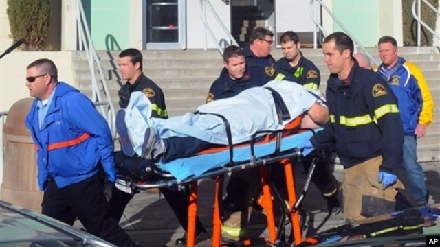 Paramedics transport student wounded during shooting Jan. 10, 2013 at San Joaquin Valley high school in Taft, Calif (Taft Midway Driller/Doug Keeler)