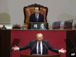 U.S. President Donald Trump delivers a speech as South Korea's National Assembly Speaker Chung Sye-kyun, top, listens at the National Assembly in Seoul, South Korea, Nov. 8, 2017.