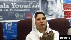 A member of a provincial assembly offers a prayer on Malala Day in Peshawar, Pakistan, November 10, 2012.