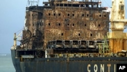 The MV Pacific Express, which was set on fire by suspected Somali pirates, is towed by Kenya Ports Authority, Sept. 21, 2011.