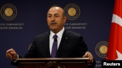 Turkish Foreign Minister Mevlut Cavusoglu speaks during a news conference in Ankara, April 16, 2018.