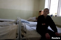 FILE - An inmate sits in the multi-drug-resistant tuberculosis ward in a prison hospital in Russia.