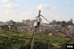 A small, portable transformer connects to a house. About 60 percent of Kibera is legally connected to such transformers, according to Kenya Power and Lighting Company. (R. Ombuor/VOA)
