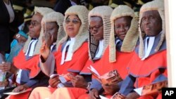 FILE: Judges are seen during the inauguration ceremony of Zimbabwean President Emmerson Mnangagwa, at the National Sports Stadium in Harare, Sunday, Aug. 26, 2018. (AP Photo/Tsvangirayi Mukwazhi)