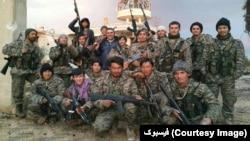 شماری از جنگجویان افغان در یکی از جبهات جنگ در سوریه