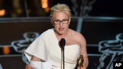 "Patricia Arquette accepts the award for best actress in a supporting role for ""Boyhood"" at the Oscars on Sunday, Feb. 22, 2015, at the Dolby Theatre in Los Angeles."