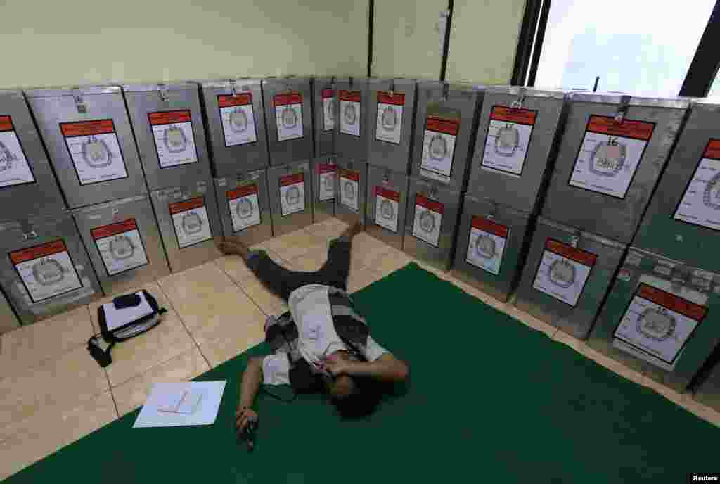 A man take a rest near ballot boxes at Bendungan Hilir in Jakarta, July 10, 2014.