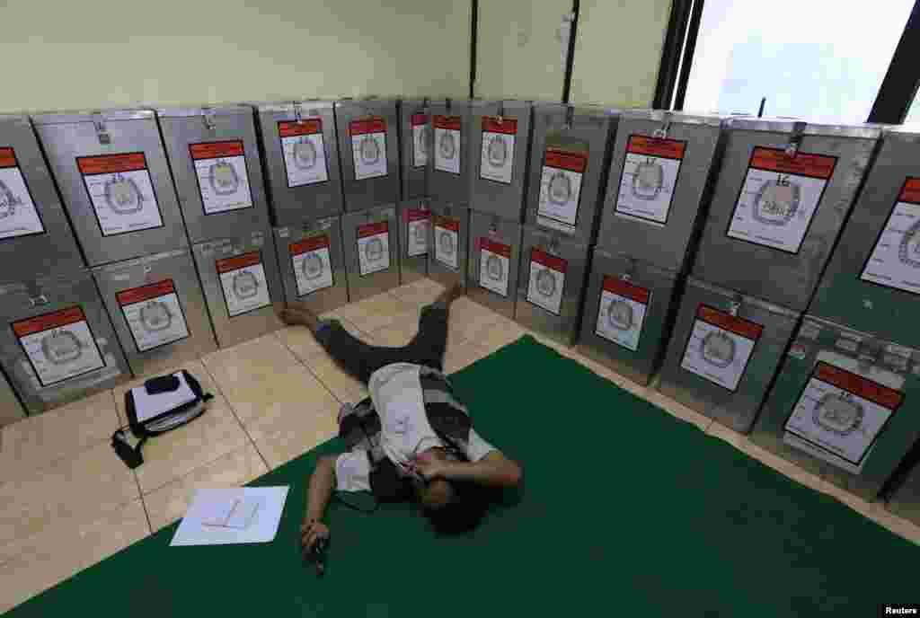 A man take a rest near ballot boxes at Bendungan Hilir in Jakarta, July 10, 2014.