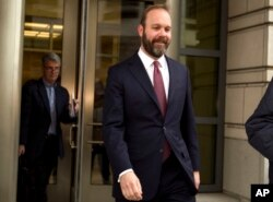 Rick Gates leaves US federal court house in Washington D.C. after pleading guilty to lying and conspiracy charges, Feb. 23, 2018.