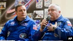 Russian cosmonaut Fyodor Yurchikhin, right, speaks as U.S. astronaut Jack Fischer listens during a news conference in Kazakhstan, April 19, 2017.