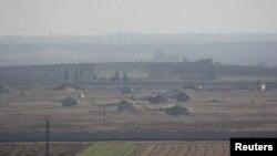Máy bay trực thăng của lực lượng trung thành với Tổng thống Syria tại một căn cứ quân sự ở Taftanaz gần phía bắc tỉnh Idlib.