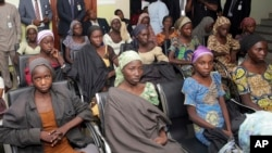 In this photo released by the Nigeria State House, Chibok schoolgirls recently freed from Boko Haram captivity are seen during a meeting with Nigeria's Vice President Yemi Osinbajo, in Abuja, Nigeria, Oct. 13, 2016.
