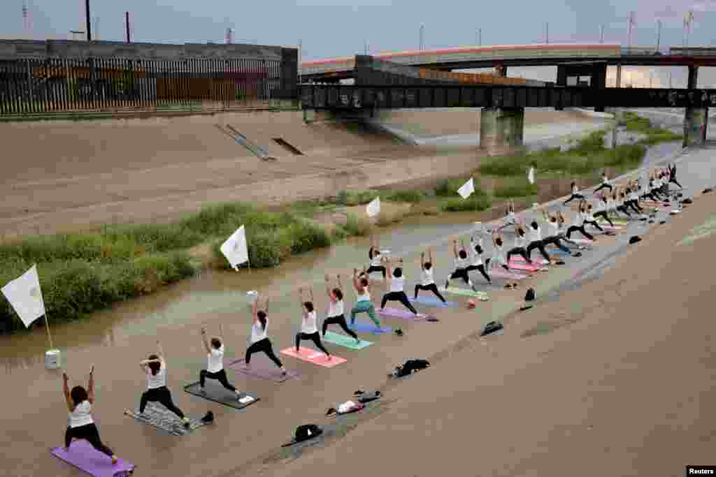 People practice yoga at the Rio Grande at the border between Mexico and U.S, in Ciudad Juarez, Mexico, Sept. 15, 2019.
