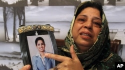 Pakistani mother, Sarwari Begum, shows a picture of her daughter, Bushra Khalique, 27, who is reportedly missing after a crush during the Hajj pilgrimage in Saudi Arabia, Sept. 26, 2015 in Karachi, Pakistan.