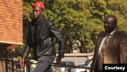 FILE: Obey Sithole going to the Magistrates Courts accompanied by an unidentified person.