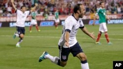 FILE - United States' Landon Donovan celebrates his goal against Mexico during the second half of a World Cup qualifying soccer match Sept. 10, 2013.