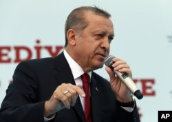 Turkey's President Recep Tayyip Erdogan addresses his supporters during an opening ceremony in Istanbul, May 6, 2016.