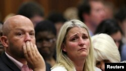 The family members of Reeva Steenkamp react as the verdict is handed down, Sept. 12, 2014.