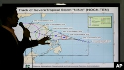 Filipino weather specialist Benison Estareja shows the track of Tropical Storm Nock-Ten during a press conference in Quezon city, north of Manila, Philippines, Dec. 23, 2016.