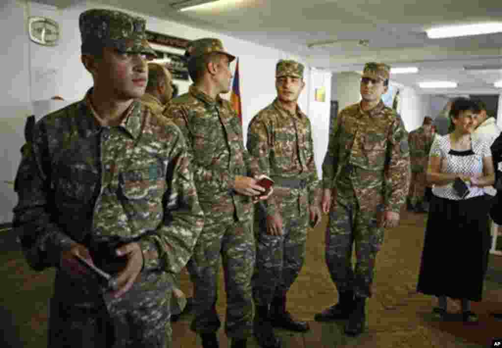 Armenian soldiers queue to cast their ballots, during parliamentary elections in Yerevan, Armenia on Sunday, May 6, 2012. (AP Phoro /PanARMENIAN , Vahan Stepanyan)