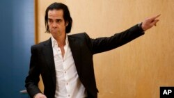 FILE - Australian musician Nick Cave poses during a photo call promoting his album 'Push the Sky Away' in Mexico City, Mexico, Feb. 18, 2013.