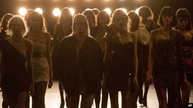 FILE- Models wear new creations for a fashion show in Paris, March 2015.