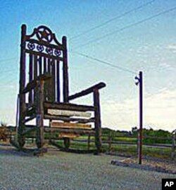 This is said to be the world's largest rocking chair, in Natty Flat, Texas. If it isn't it's gotta be close. Texas probably has a world-record cowboy to sit in it, too