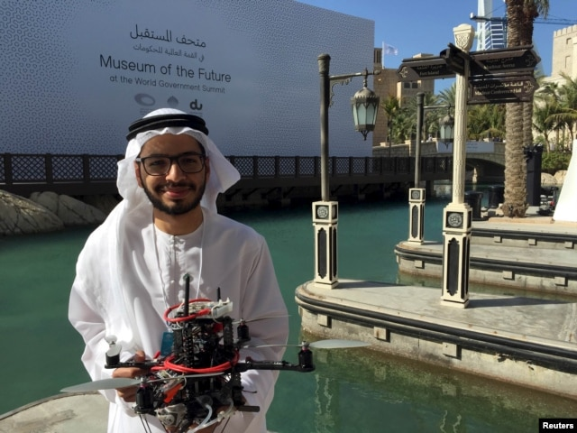 "Emirati Ph.D student Talib alHinai poses with the drone prototype he and his classmates at Imperial College London built, which won a prize at state-sponsored ""Drones for Good"" competition, in Dubai, UAE, Feb. 10, 2016."