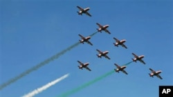 Indian air force aircraft perform aerobatic flight at the opening ceremony of Aero India 2011 in Yelahanka air base on the outskirts of Bangalore, India, February 9, 2011.