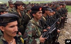 FILE - Revolutionary Armed Forces of Colombia (FARC) rebels, shown in 2000.