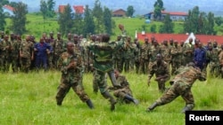 M23 soldiers demonstrate unarmed combat at Rumangabo military camp, North Kivu April 27, 2013. Rebels are honing their ambush skills to prepare to face a new United Nations force which has a mandate to go on the offensive.