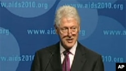 President Clinton speaking at the 18th International AIDS Conference in Vienna.