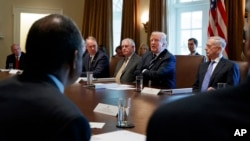 """FILE - President Donald Trump speaks during a Cabinet meeting at the White House in Washington, Oct. 16, 2017. The White House has begun work on one of Trump's next priorities: welfare reform. Trump said at the Cabinet meeting that welfare reform was """"becoming a very, very big subject, and people are taking advantage of the system."""""""