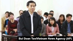 FILE - Vietnam's prominent blogger Nguyen Huu Vinh, shown on trial in Hanoi, Vietnam.