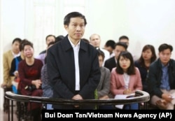 FILE - Vietnam's prominent blogger Nguyen Huu Vinh, shown on trial in Hanoi, Vietnam, was sentenced to five years in prison for posting anti-state writings.