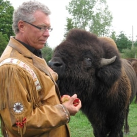 John Trippy, owner of the Wild Winds Buffalo Preserve, with one of his animals.